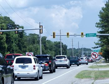 Barriers keep drivers from making left hand turn onto Dogwood Trail.