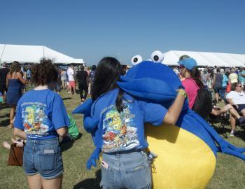 Outer Banks Seafood Fest mascot gives volunteer a hug.