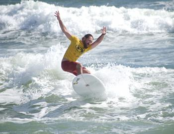 ESA Longboard Surfer catching a wave as summer ends on the Outer Banks.