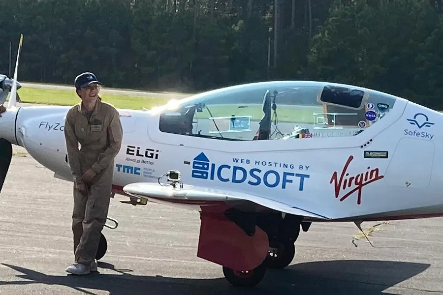 Zara Rutherford with her aircraft at Wright Brothers Memorial Airport. Photo Mark Jurkowitz, Outer Banks Voice.