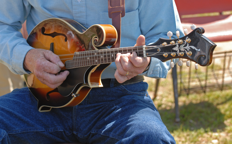 A musician plays at the Bluegrass Island Festival